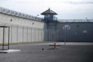 Prison yard with watch tower and security