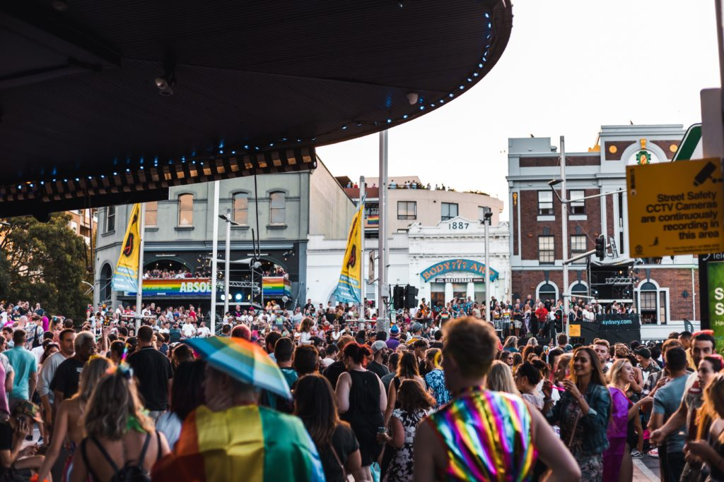 People gathers at a pride event dressed in rainbows