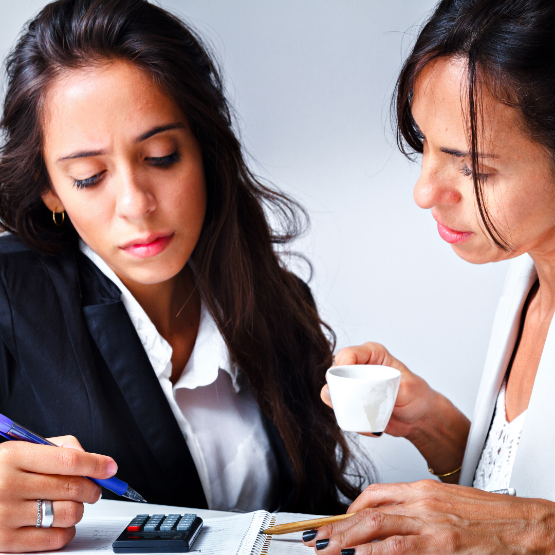 Two women working on a budget