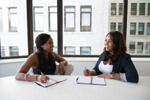 two women discuss business